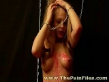 Blonde slave takes pain in her pussy and tits
