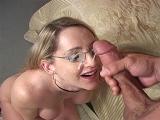 Lori Lust takes cum across her glasses