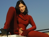 Angie in red spandex suit